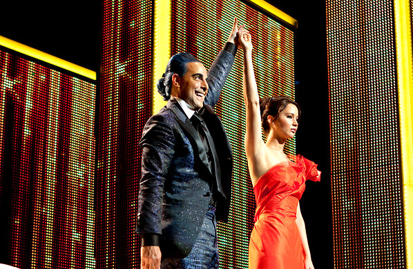 Ceasar Flickerman (Stanley Tucci) introducing Katniss Everdeen (Jennifer Lawrence) in The Hunger Games (2012)