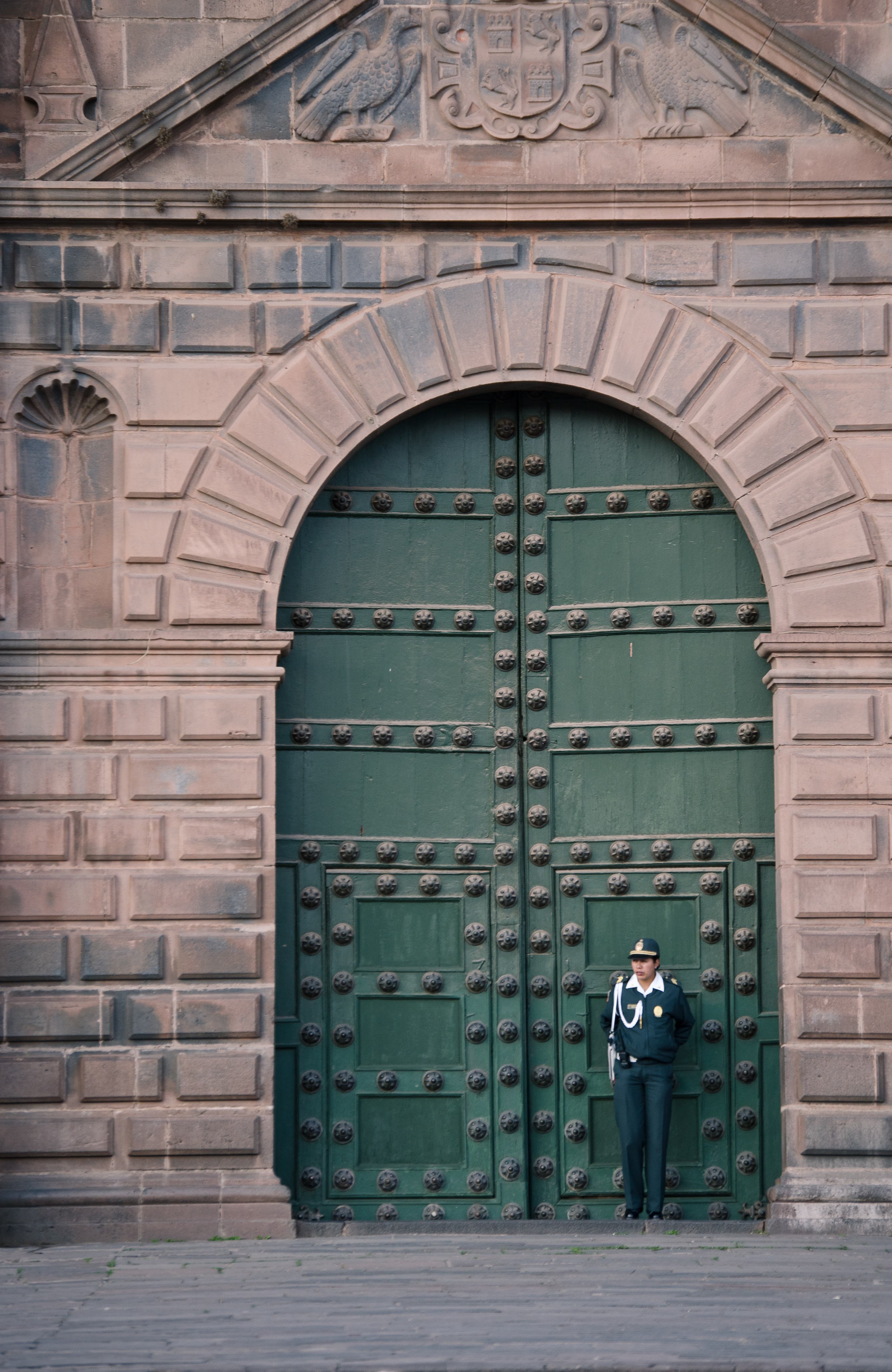 Photo: Policewoman in front of Cusco's Cathedral. Taken by myself.