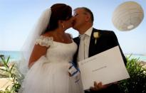 A Lebanese couple weds in a civil ceremony in Cyprus. Lebanon's grand mufti has spoken out against civil marriage. (AFP photo, text and photo taken from Now.mmedia.me)