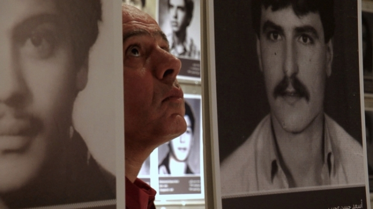 Assaad Chaftari walking in an exhibition of the disappeared