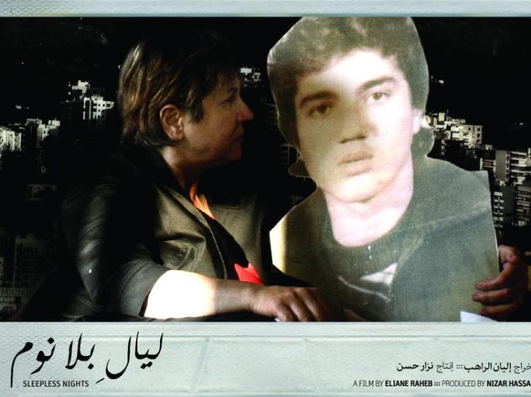 Maryam Saiidi with a cardboard of her son
