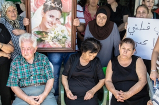 Roula's mother is sitting in the middle. She could barely handle herself. Between her tears and her cries, there wasn't much any of us could say. On the left sits her father. He kept on trying to maintain a image of strength but soon left when he couldn't control himself anymore.