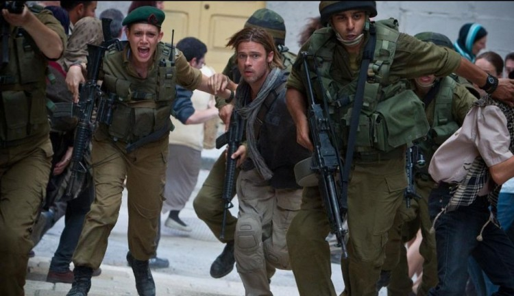 Daniella Kertesz (left) and Brad Pitt (right) in World War Z during the scene in Israel