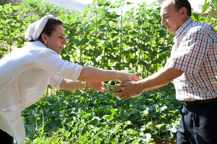 "Credit: UNHCR's Facebook Page ""What an act of generosity. Foddiye, left, and her husband currently host 7 Syrian refugee families rent-free on their land in Lebanon. It's the Islamic month of fasting, Ramadan, and here she is picking vegetables from her garden with Abou, a Syrian refugee, for Iftar, the meal that opens the fast.  Foddiye says, ""This is the most beautiful Ramadan I have spent in 20 years."" Here's a video that explains why: http://rfg.ee/nnhUu  For more photos of refugees and Ramadan: http://rfg.ee/nnhEs"""