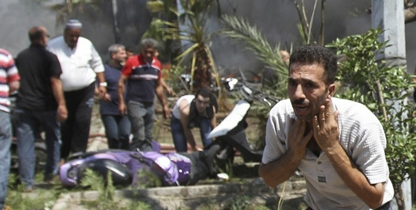 A man reacts outside one of two mosques hit by explosions in Lebanon's northern city of Tripoli.