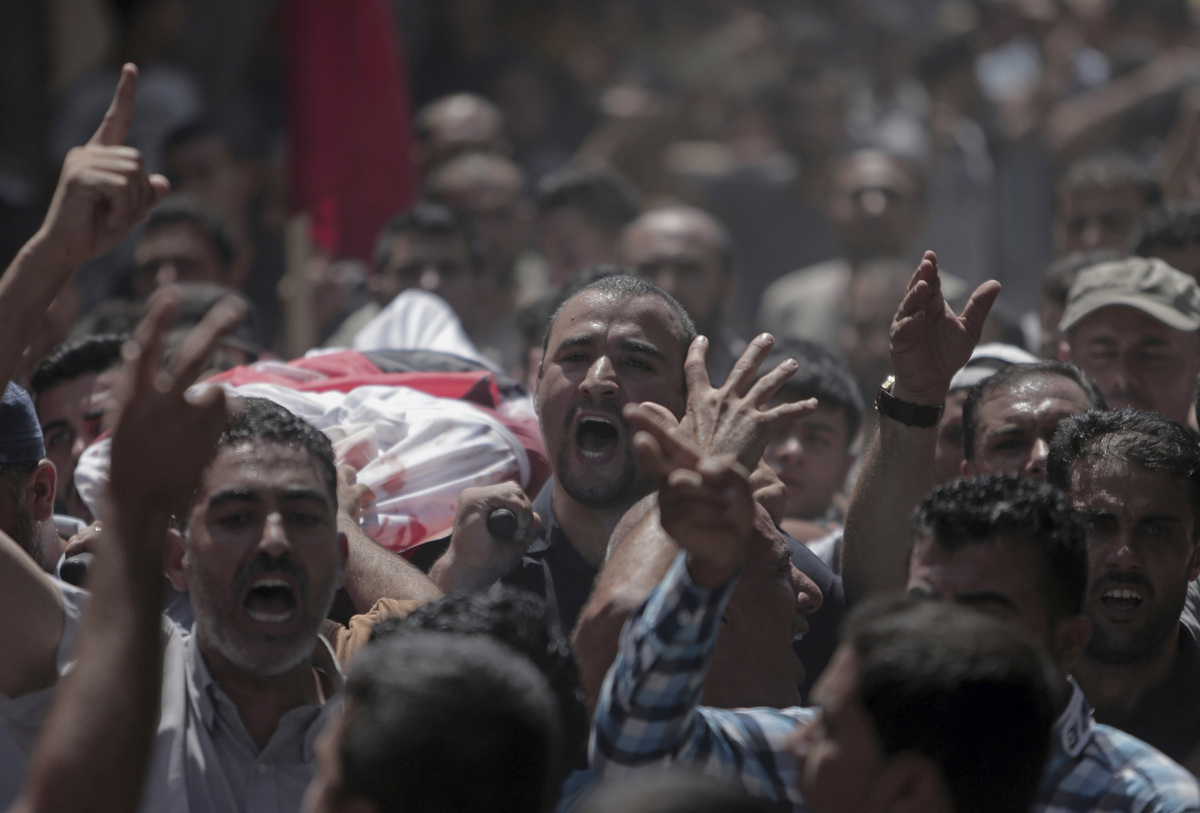 Palestinian mourners carry bodies of the five members of the Hamad family who were killed in an Israeli missile strike late Tuesday, in town of Beit Hanoun, northern Gaza Strip, Wednesday, July 9, 2014. The Israeli army on Wednesday intensified its offensive on the Hamas-run Gaza Strip, striking Hamas sites and killing more than a dozen of people on the second day of a military operation it says is aimed at quenching rocket fire against Israel. (AP Photo/Khalil Hamra)
