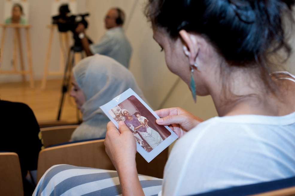 Audience member looks at a picture that was presented to the public during the panel discusion at IFI in AUB, October 8, 2014, Beirut. Photo by Marta Bogdanska