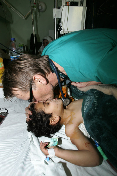 The widely shared photo of Dr Gilbert with a patient in Al Shifa Hospital during 'Operation Protective Edge'