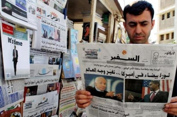Man reading a newspaper in Lebanon. Photo by Hurriyet.